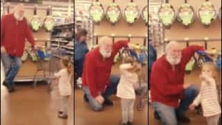 Awwwww: Little girl mistakes bearded man for Santa Claus and he plays along!