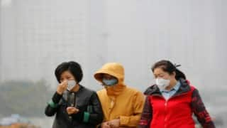Beijing lifts red alert for smog