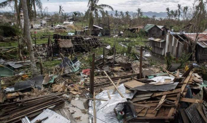 millions without power three dead as typhoon hits. Black Bedroom Furniture Sets. Home Design Ideas