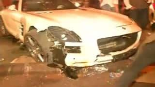 Five hurt as SUV rams into pavement; car driver arrested