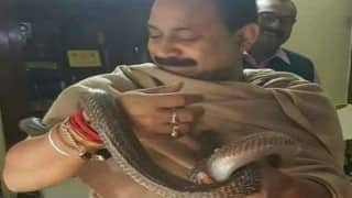Bihar Education Minister Ashok Chaudhary wraps snake in hand, photo goes viral