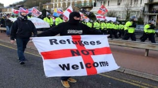 Nine arrested as UK immigration protests prompt clashes