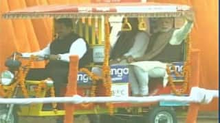 Prime Minister Narendra Modi interacts with rickshaw pullers, distributes e-rickshaws