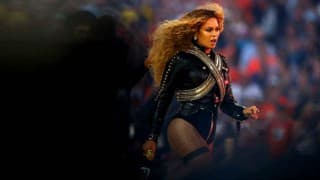 Beyonce Knowles stumbles on stage