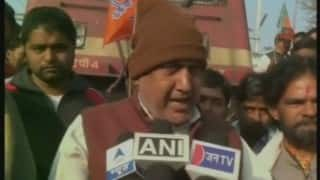 BJP workers stop train in protest against Visheshwar Ojha's murder