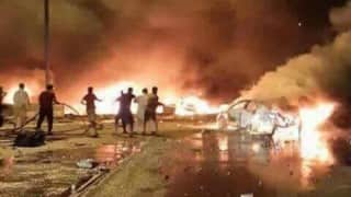 Iraq: Twin bombing attacks in Baghdad market kill at least 59