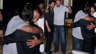 Spotted: Shah Rukh Khan giving hug to Sanjay Dutt outside his residence