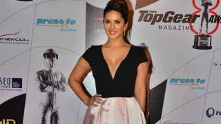 Sunny Leone awkwardly hides cleavage at an awards show and it seems weird! See picture