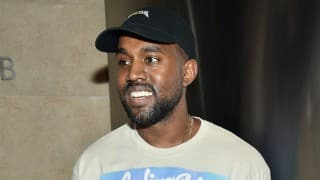 Kanye West stops paparazzi fight at airport