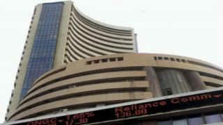 Sensex, Nifty close at record highs, auto stocks rise