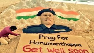 Sudarsan Pattnaik, creates sand sculpture to pray for speedy recovery of Lance Naik Hanumanthappa Koppad