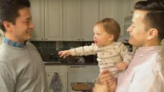 When sweet baby meets dad's twin brother, his reaction is super funny