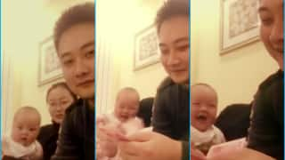 Amused baby laughs hysterically watching her father count money! Watch video