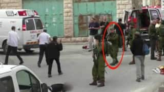Israel soldier caught shooting wounded Palestinian shot in head, soldier detained after video goes viral (Watch video)