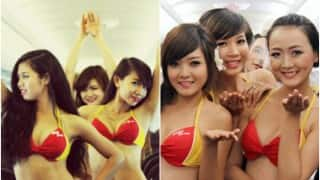 Woah! Bikini-clad Vietnamese flight attendants entertain passengers with sexy dance (Watch Video)