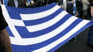 Greece clears bailout hurdle with debt relief pledge