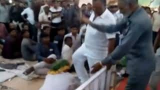 Shocking! BJP lawmaker Vitthal Radadiya repeatedly kicks an old man at a religious function (Watch Video)