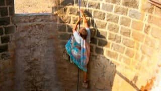 In this village, women jump into wells daily to draw water using cups and jugs!