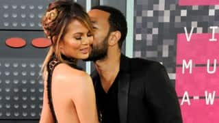 Chrissy Teigen criticized for first outing since giving birth