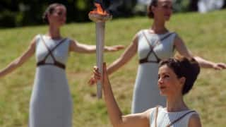 Flame lit for troubled Rio Games