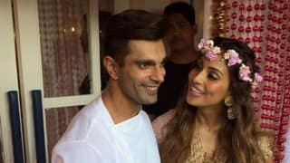 Bipasha Basu-Karan Singh Grover wedding: B'town couple poses for media after Mehendi ceremony (Video)