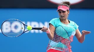 Sania Mirza, Martina Hingis labour into second round of French Open