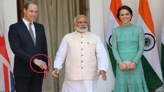 PM Narendra Modi's powerful tea-seller handshake leaves palm-print on Prince William; picture goes viral!