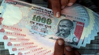Rupee sinks 21 paise vs dollar in early trade
