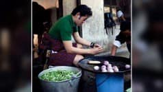 This photo of Bhutan's King Jigme Wangchuck chopping onions for community children is going viral!