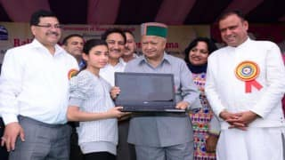Himachal Pradesh CM Virbhadra Singh distributes free laptops to meritorious students