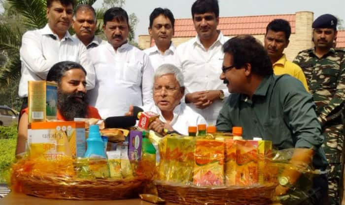 Baba Ramdev gifts Lalu Yadav Patanjali products Images Pics for free download