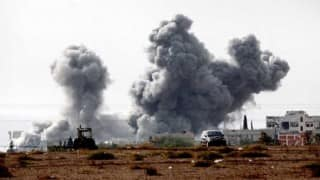 Bombs kill 8 in northeast Syria as US commander visits