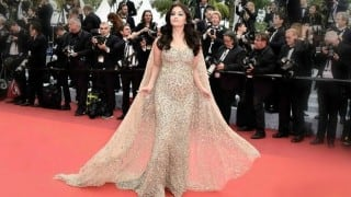 One day I'll walk red carpet in white shirt and jeans, quips Aishwarya Rai Bachchan
