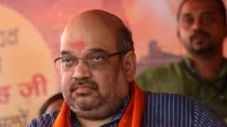Oomen Chandy should apologise for 'starvation' deaths in Kerala: Amit Shah