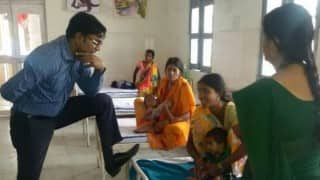 Caught on camera: Picture of young IAS officer standing in 'arrogant' manner while meeting patients goes viral