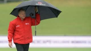 Cricket umpire Bruce Oxenford dons bizarre protective shield to guard himself