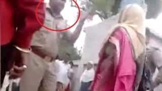 Shocking! UP police man caught on camera abusing elderly woman and threatening to strip her and beat her up in Faizabad