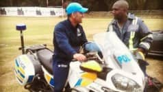 India tour of Zimbabwe 2016: Motorcycle lover MS Dhoni checks out Policeman's bike in Harare