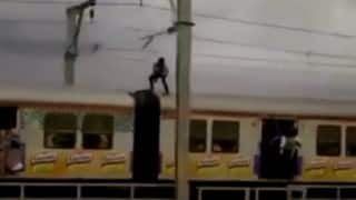 Man pulls life-threatening stunt atop Mumbai local train (Watch Video)