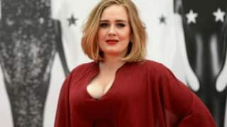 WTF! Adele plants kiss on fan's lips (Watch Video)
