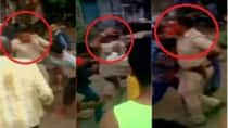 Gujarat: Locals thrash police officer, after death of a youth in Surat (Watch Video)