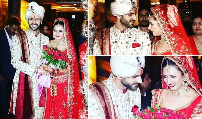 Divyanka Tripathi & Vivek Dahiya wedding: The newly wed couple is going on secret honeymoon and Divyanka is stopping her man from revealing the plan – watch video!