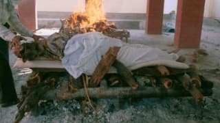 Dalit forced to cremate wife's body in front of house