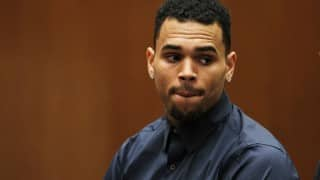 SHOCKING! Chris Brown arrested for threatening woman with gun