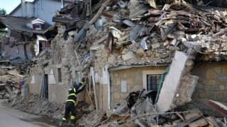 Italy buries quake dead, recalls sisters embracing in rubble
