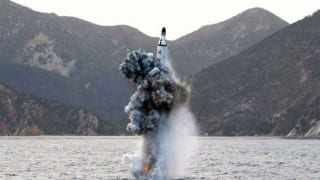 North Korea test fires submarine-launched missile after threatening nuclear strike