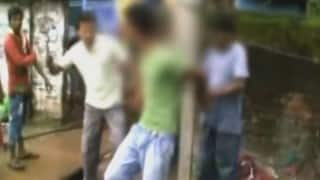 Shocking video! 26-year-old man tied to lamp post, thrashed for stealing mobile