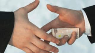 Forest Range Officer caught taking bribe