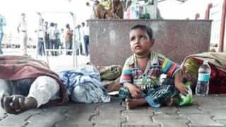 3 Year old kid found playing next to dead parents on station thinking they are only asleep and will wake up!