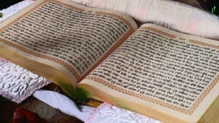 Sikh holy book thrown over locked gates of UK gurdwara
